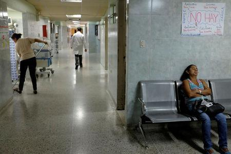 A woman sleeps in a seat at the waiting room of the pediatric emergency at the Universitary Hospital, in Merida, Venezuela June 17, 2016. REUTERS/Marco Bello