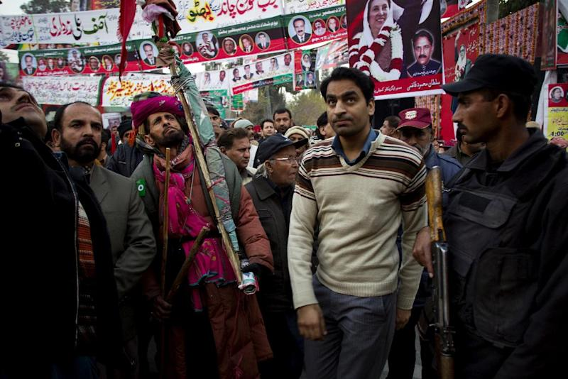 Supporters of Pakistan's assassinated leader Benazir Bhutto listen to speeches during her fifth death anniversary in Rawalpindi, Pakistan, Thursday, Dec. 27, 2012. The 24-year-old son of former Pakistani Prime Minister Benazir Bhutto has launched his political career at his ancestral place Larkana, with a fiery speech on the fifth anniversary of his mother's assassination. (AP Photo/B.K. Bangash)