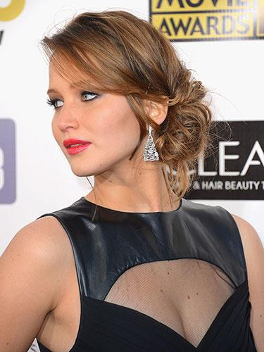 "<div class=""caption-credit""> Photo by: Mark Davis</div><div class=""caption-title"">Jennifer Lawrence</div>This is the messy side-bun perfected. Pull out your bangs to make it look less formal. <br> <br> <b>More from REDBOOK: <br></b> <ul>  <li>  <a rel=""nofollow"" target="""" href=""http://www.redbookmag.com/beauty-fashion/tips-advice/celebrity-hair-how-to?link=rel&dom=yah_life&src=syn&con=blog_redbook&mag=rbk""><b>100 Hot Celebrity Hairstyles For Every Hair Type</b></a>  </li>  <li>  <a rel=""nofollow"" target="""" href=""http://www.redbookmag.com/beauty-fashion/tips-advice/work-wear?link=rel&dom=yah_life&src=syn&con=blog_redbook&mag=rbk""><b>The Most Iconic Workwear of All Time  <br></b></a>  </li> </ul>"