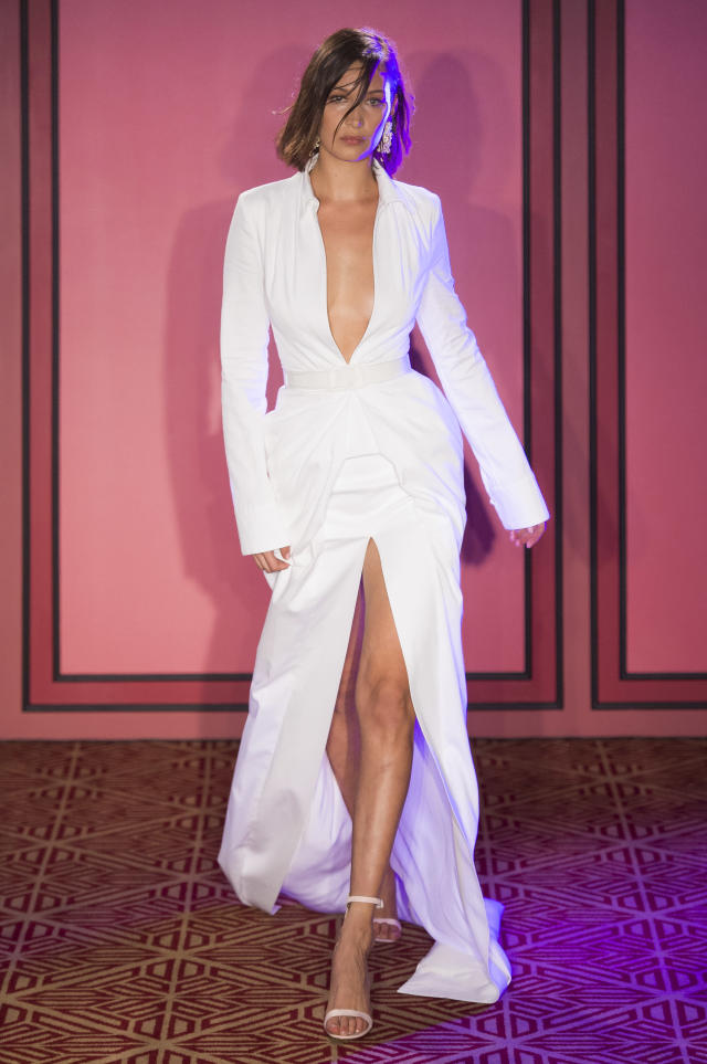 <p><i>Model Bella Hadid wears a white, deep-cut dress from the SS18 Brandon Maxwell collection. (Photo: IMAXtree) </i></p>