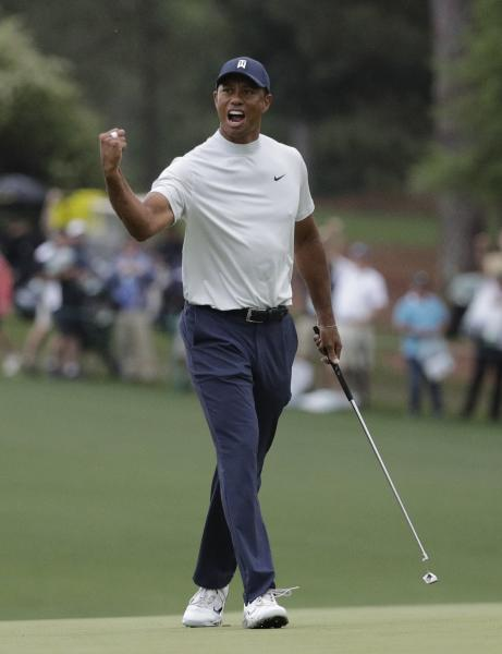 Tiger Woods reacts to his birdie putt on the 15th hole during the second round for the Masters golf tournament Friday, April 12, 2019, in Augusta, Ga. (AP Photo/David J. Phillip)