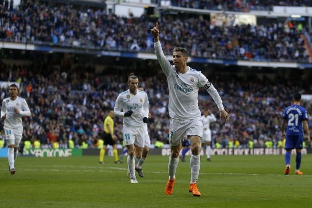 Real Madrid's Cristiano Ronaldo celebrates after scoring the opening goal against Alaves during the Spanish La Liga soccer match between Real Madrid and Alaves at the Santiago Bernabeu stadium in Madrid, Saturday, Feb. 24, 2018. (AP Photo/Francisco Seco)