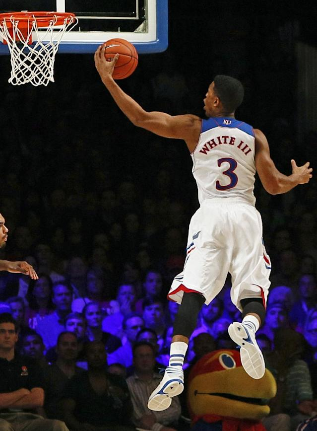 Kansas' Andrew White III drives for a layup during the first half of an NCAA college basketball game against Villanova in Paradise Island, Bahamas, Friday, Nov. 29, 2013. (AP Photo/Bahamas Visual Services, Dante Carrer)