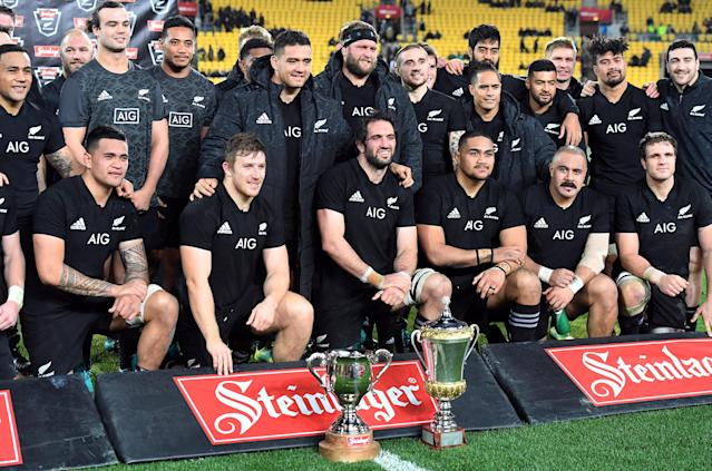 Rugby Union - June Internationals - New Zealand vs France - Westpac Stadium, Wellington, New Zealand - June 16, 2018 - New Zealand team players pose with the Gallagher cup after the game. REUTERS/Ross Setford
