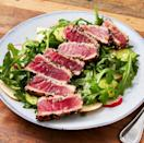 """<p>If it wasn't already obvious, the most important part of this recipe is the fish. Make sure you're getting quality sushi-grade Ahi Tuna—it tastes MUCH better raw than your average supermarket cut of tuna. </p><p>Get the <a href=""""https://www.delish.com/uk/cooking/recipes/a29869428/seared-ahi-tuna-steak-recipe/"""" rel=""""nofollow noopener"""" target=""""_blank"""" data-ylk=""""slk:Seared Ahi Tuna & Rocket Pear Salad"""" class=""""link rapid-noclick-resp"""">Seared Ahi Tuna & Rocket Pear Salad</a> recipe.</p>"""