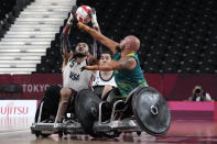 United States' Charles Aoki and Australia's Ryley Batt battle for the ball during a semifinal wheelchair rugby match against Australia at the Tokyo 2020 Paralympic Games, Saturday, Aug. 28, 2021, in Tokyo, Japan. (AP Photo/Kiichiro Sato)