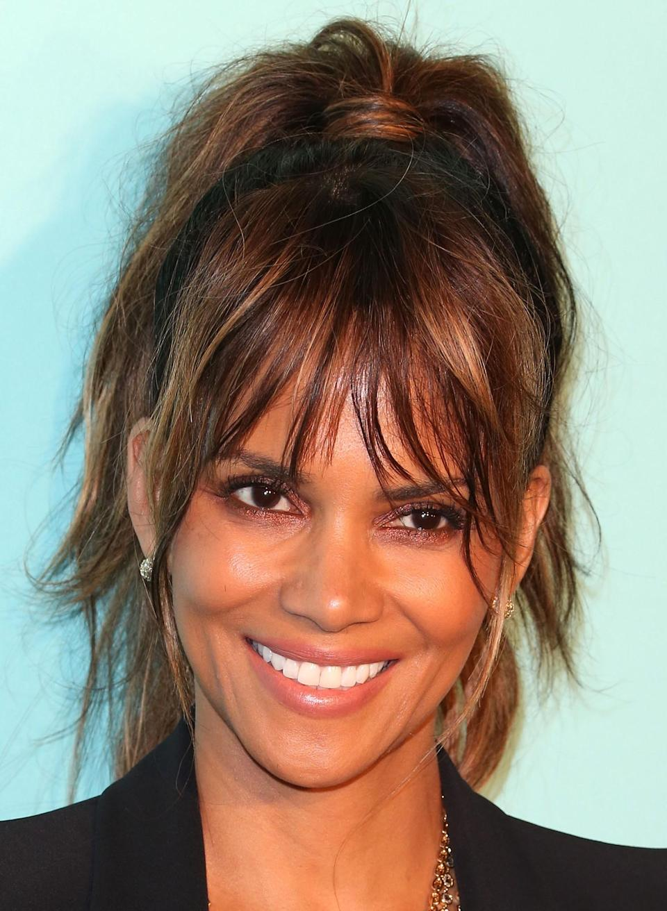 """<p>In 2002, the well-known face became the first black woman to win an Oscar for Best Leading Actress. She won the acclaimed statue for her role in Monster's Ball, a romantic Southern drama. Halle's emotional acceptance speech is still remembered today as she thanked those who had forged the path for her: """"This moment is so much bigger than me. It's for every nameless, faceless woman of colour that now has a chance because this door tonight has been opened."""" <i>[Photo: Getty]</i> </p>"""