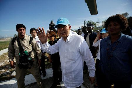 UN Secretary General Ban Ki Moon waves before his departure from MINUSTAH base at the end of a visit after Hurricane Matthew in Les Cayes, Haiti, October 15, 2016. REUTERS/Andres Martinez Casares
