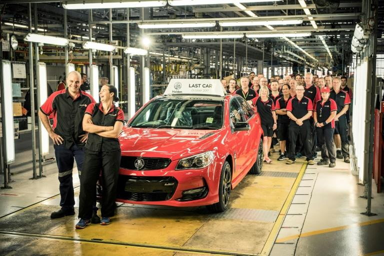 Workers with the last Holden car to roll off the production line at Elizabeth in Adelaide, on October 20, 2017