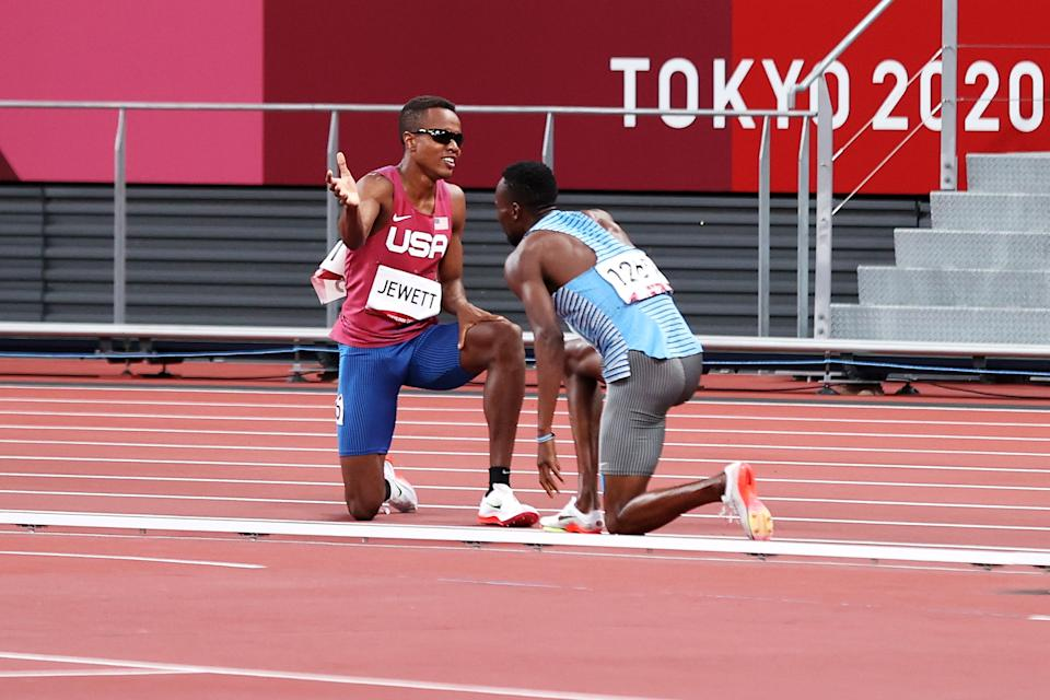 TOKYO, JAPAN - AUGUST 01: Isaiah Jewett of Team United States and Nijel Amos of Team Botswana react after falling in the Men's 800m Semi-Final on day nine of the Tokyo 2020 Olympic Games at Olympic Stadium on August 01, 2021 in Tokyo, Japan. (Photo by Christian Petersen/Getty Images)