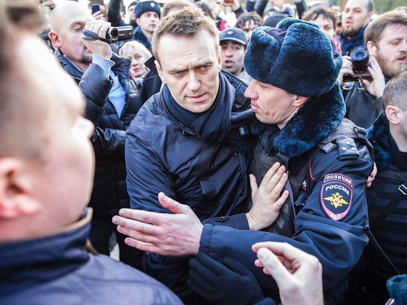 Police officers detaining Kremlin critic Alexei Navalny during an unauthorised anti-corruption rally in central Moscow: AFP/Getty Images
