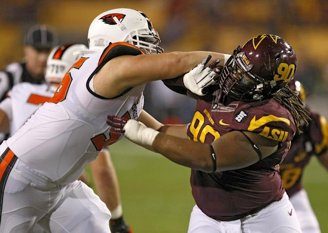 Arizona State defensive tackle Will Sutton (90) battles with Oregon State center Isaac Seumalo (56) during the first half of an NCAA college football game on Saturday, Nov. 16, 2013, in Tempe, Ariz. (AP Photo/Rick Scuteri)