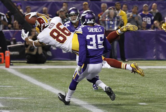 Washington Redskins tight end Jordan Reed (86) dives to the end zone in front of Minnesota Vikings cornerback Marcus Sherels on an 11-yard touchdown reception in the first half of an NFL football game, Thursday, Nov. 7, 2013, in Minneapolis. (AP Photo/Ann Heisenfelt)