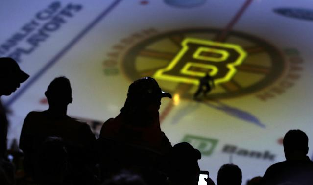 Fans wait for Game 5, between the Boston Bruins and Montreal Canadiens, in the second-round of the Stanley Cup hockey playoff series in Boston, Saturday, May 10, 2014. (AP Photo/Charles Krupa)