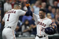Houston Astros' Jose Altuve (27) celebrates with Carlos Correa (1) after hitting a home run against the Chicago White Sox during the sixth inning of a baseball game Thursday, June 17, 2021, in Houston. (AP Photo/David J. Phillip)