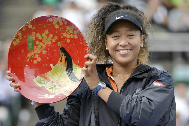 Japan's Naomi Osaka poses for a photo during an award ceremony after winning the Toray Pan Pacific Open tennis tournament in Osaka, western Japan, Sunday, Sept. 22, 2019. Osaka won her first singles title since the Australian Open in January by beating Russia's Anastasia Pavlyuchenkova 6-2, 6-3 in the Toray Pan Pacific final. (Kyodo News via AP)