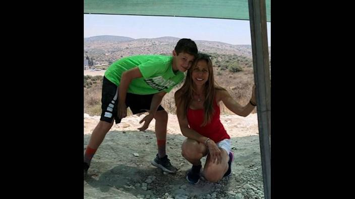 Stacie Fang with her son, 15-year-old Jonah Handler. Both were pulled alive from the rubble of the Surfside condo collapse. Stacie Fang later died, but Jonah has survived.