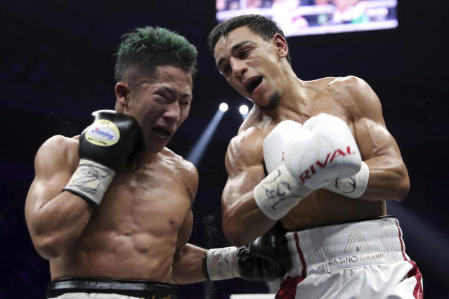 France's Nordine Oubaali, right, and Japan's Takuma Inoue exchange their punches in the ninth round of their WBC world bantamweight title match in Saitama, Japan, Thursday, Nov. 7, 2019. Oubaali defeated Inoue by a unanimous decision. (AP Photo/Toru Takahashi)