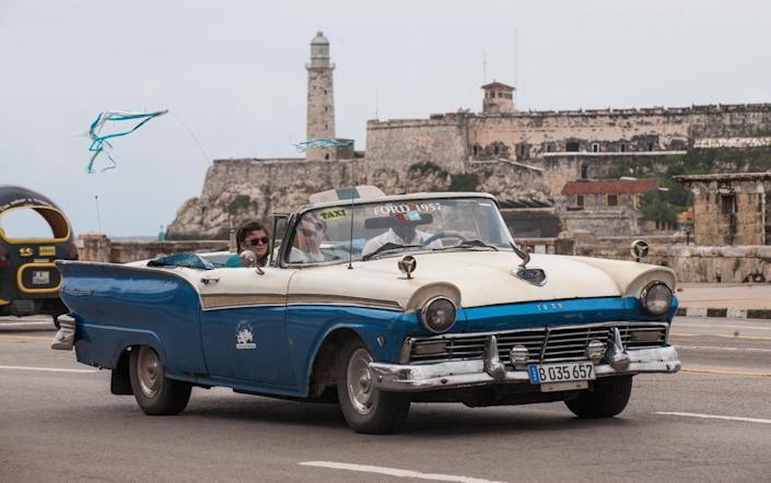The US will ease travel and trade restrictions with Cuba after agreeing to restore ties severed since 1961 (AFP Photo/Yamil Lage)
