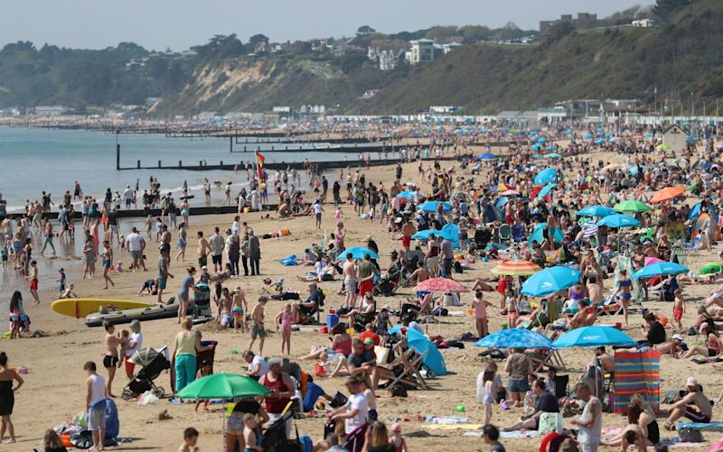 People enjoy the hot weather at Bournemouth beach, Dorset - PA