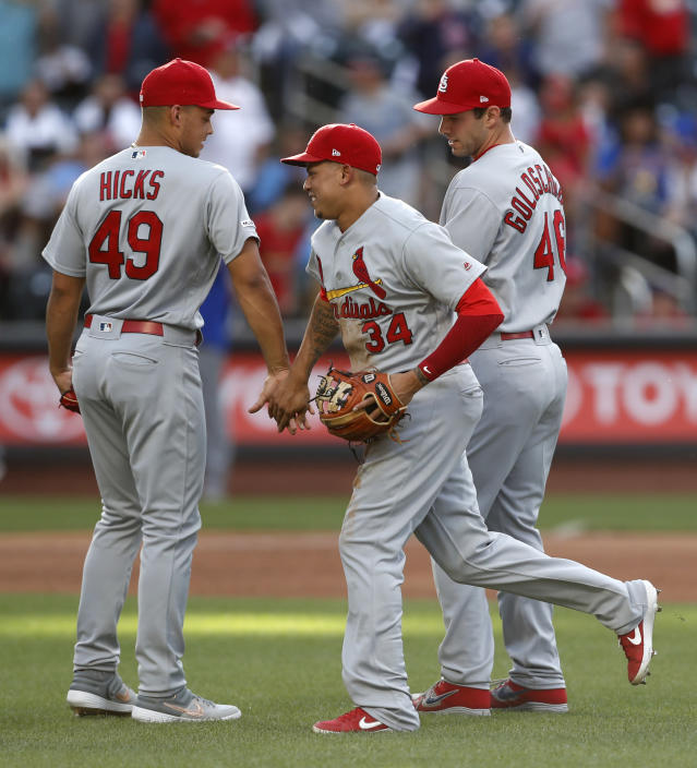 St. Louis Cardinals shortstop Yairo Munoz (34) celebrates with relief pitcher Jordan Hicks (49) and first baseman Paul Goldschmidt, right, after the Cardinals defeated the New York Mets 5-4 in the 10th inning of a baseball game Friday, June 14, 2019, in New York, that had been suspended Thursday because of rain. (AP Photo/Kathy Willens)