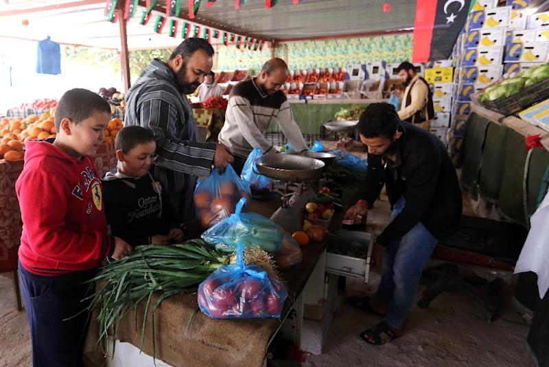 Libyans shop for fruits and vegetables at a market in Sabratha, west of the capital Tripoli, on February 29, 2016 (AFP Photo/Mahmud Turkia)
