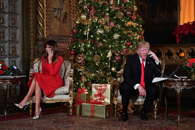 <p>DEC. 24, 2017 – President Donald J. Trump and the First Lady Melania Trump participate in NORAD Santa Tracker phone calls at the Mar-a-Lago resort in Palm Beach, Florida . (Photo: Nicholas Kamm/AFP/Getty Images) </p>