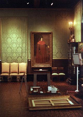 "FILE PHOTO: The empty frame of Rembrandt's oil painting ""A Lady and Gentleman in Black"" lies on the floor and a space on the wall (left) remains bare where the ""The Storm on the Sea of Galilee"" once hung in the Isabella Stewart Gardner Museum in Boston, Massachusetts, U.S. on March 21, 1990.  Reuters/Jim Bourg/File Photo"