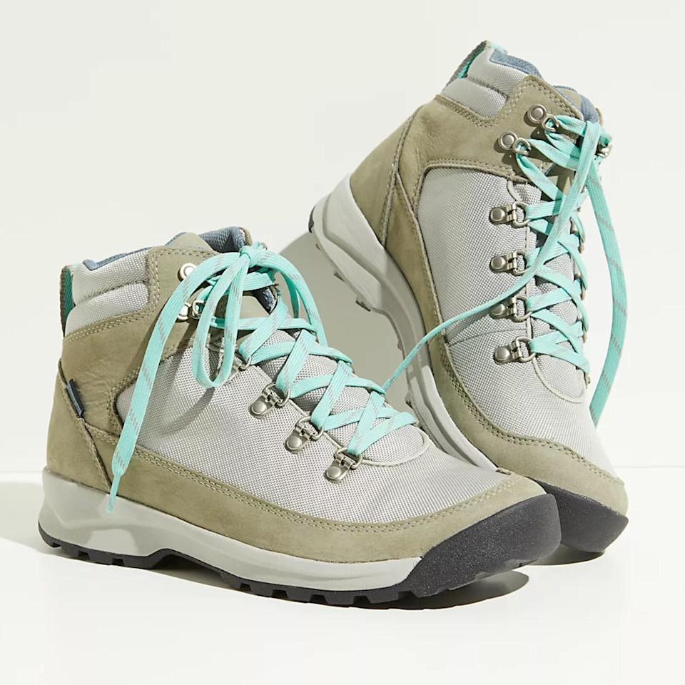 """If you want something lighter than leather but just as versatile, check out these Danner's, featuring a mesh-like waterproof lining and suede trim. The D-ring hooks allow you to fasten the shoe quickly and tightly, so you get more ankle and foot support than a traditional lace-up bootie. The turquoise adds a fun pop of color, too. $170, Free People. <a href=""""https://www.freepeople.com/shop/danner-adrika-hiker-boot/?"""" rel=""""nofollow noopener"""" target=""""_blank"""" data-ylk=""""slk:Get it now!"""" class=""""link rapid-noclick-resp"""">Get it now!</a>"""