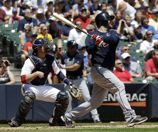 Atlanta Braves' Brian McCann, right, hits a grand slam during the first inning of a baseball game against the Milwaukee Brewers, Sunday, June 23, 2013, in Milwaukee. (AP Photo/Morry Gash)