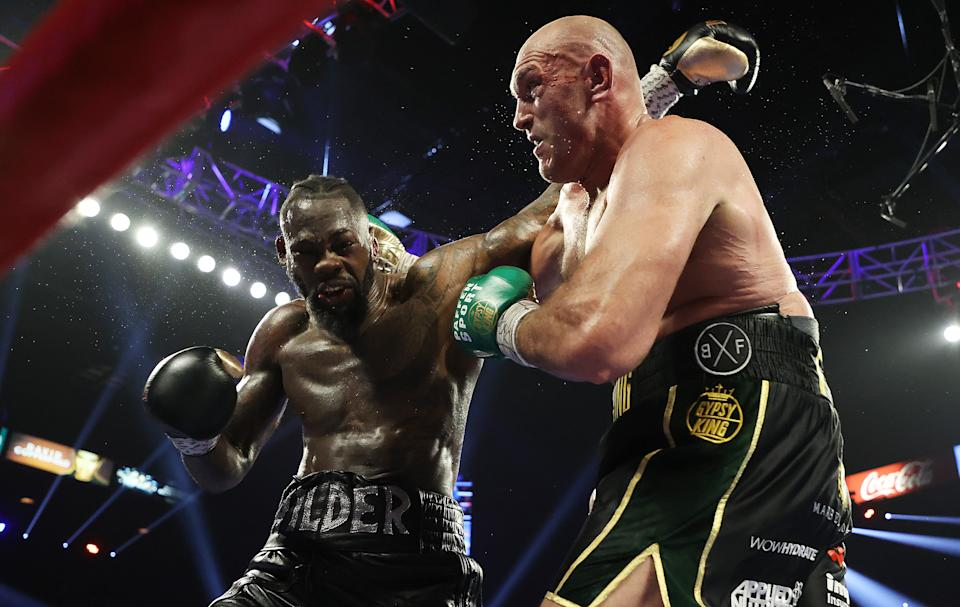 LAS VEGAS, NEVADA - FEBRUARY 22:  Tyson Fury punches Deontay Wilder during their Heavyweight bout for Wilder's WBC and Fury's lineal heavyweight title on February 22, 2020 at MGM Grand Garden Arena in Las Vegas, Nevada. (Photo by Al Bello/Getty Images)