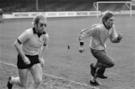 British singers Elton John (left) Rod Stewart training at Watford Football Club, London, November 1973. (Photo by Michael Putland/Getty Images)