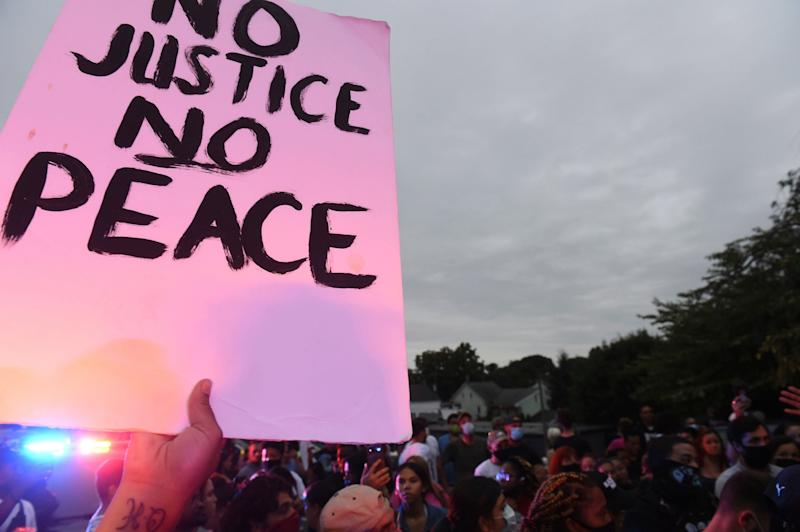 A sign at a protest at the scene of a police shooting on Laurel Street and Union Street in Lancaster city on Sunday, September 13, 2020. A man was shot by police earlier in the day after a reported domestic dispute, police said. A Lancaster city police officer fired at a 27-year-old man who was armed with a knife. The man, identified as Ricardo Munoz, was killed and pronounced dead at the scene. (Andy Blackburn/LNP/LancasterOnline via AP) (AP)