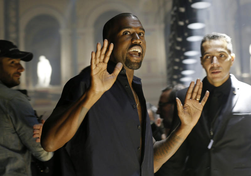 Rapper Kanye West reacts as he arrives to attend the Israeli-American designer Alber Elbaz Spring/Summer 2015 women's ready-to-wear collection for fashion house Lanvin during Paris Fashion Week September 25, 2014. REUTERS/Gonzalo Fuentes (FRANCE - Tags: FASHION)