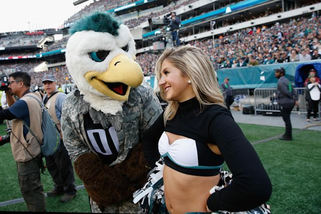 <p>Swoop, Philadelphia Eagles mascot talks with a cheerleader against the Denver Broncos during the fourth quarter at Lincoln Financial Field on November 5, 2017 in Philadelphia, Pennsylvania. The Philadelphia Eagles won 51-23. (Photo by Joe Robbins/Getty Images) </p>