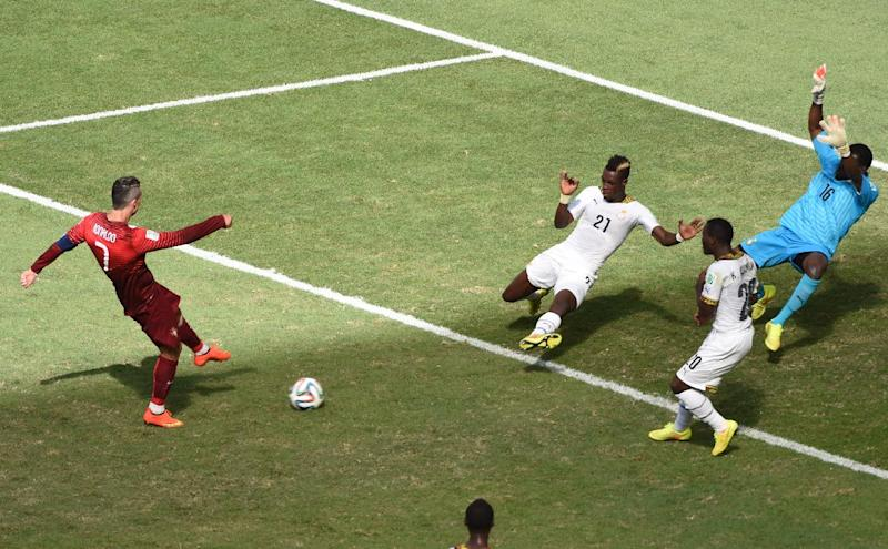 Portugal's Ronaldo (L) scores a goal against Ghana in Brasilia during the FIFA World Cup on June 26, 2014