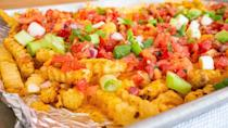 """<p>If you have frozen <a href=""""https://www.thedailymeal.com/eat/time-food-lasts?referrer=yahoo&category=beauty_food&include_utm=1&utm_medium=referral&utm_source=yahoo&utm_campaign=feed"""" rel=""""nofollow noopener"""" target=""""_blank"""" data-ylk=""""slk:french fries in your freezer"""" class=""""link rapid-noclick-resp"""">french fries in your freezer</a>, it's time to pull them out for this delicious twist on nachos. The kids will love getting a little messy when they get to mix up the ingredients — and then eat it all up.</p> <p><a href=""""https://www.thedailymeal.com/recipes/loaded-taco-fries-recipe?referrer=yahoo&category=beauty_food&include_utm=1&utm_medium=referral&utm_source=yahoo&utm_campaign=feed"""" rel=""""nofollow noopener"""" target=""""_blank"""" data-ylk=""""slk:For the Loaded Taco Fries recipe, click here."""" class=""""link rapid-noclick-resp"""">For the Loaded Taco Fries recipe, click here.</a></p>"""