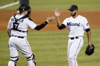 Miami Marlins catcher Chad Wallach (17) shakes hands with relief pitcher Yimi Garcia after a baseball game against the Arizona Diamondbacks, Thursday, May 6, 2021, in Miami. (AP Photo/Lynne Sladky)