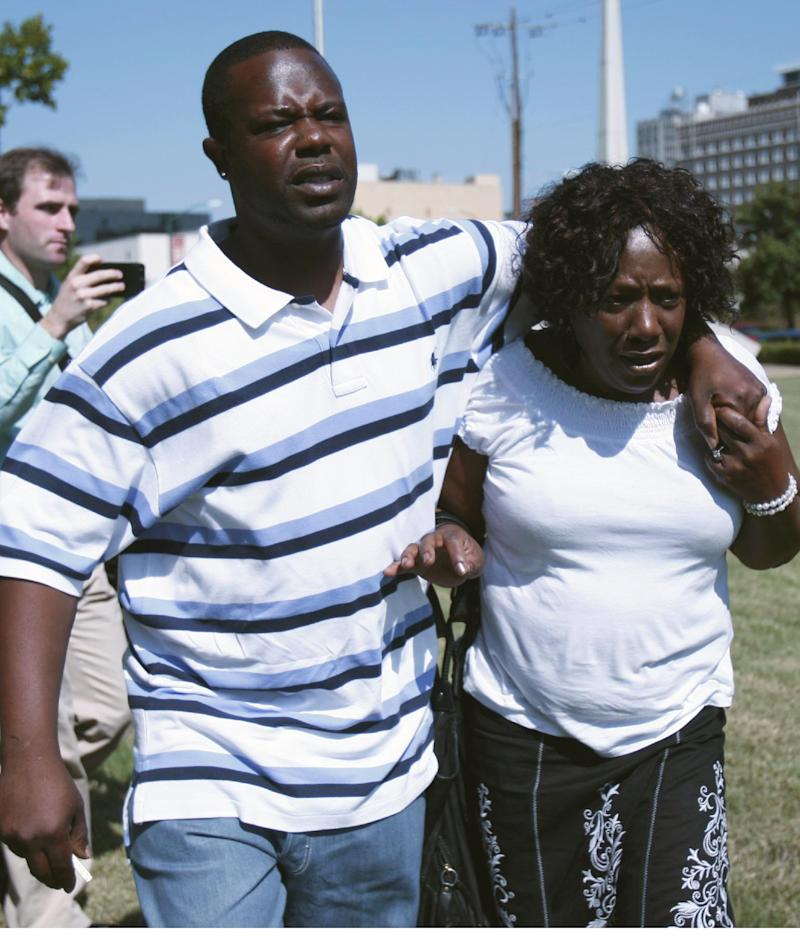 """Ablene Cooper, right,and her son Antonio Cooper,  leave the  Hinds County courtroom in Jackson, Miss., Tuesday, Aug. 16, 2011, after a circuit judge dismissed her lawsuit against Kathryn Stockett, author of the best-selling novel """"The Help.""""    """"The Help"""" was made into a movie that opened last week. It's based on relationships between white families and the African-American women who worked for them in the 1960s. The lawsuit was filed by  Cooper,  who works for Stockett's brother. She claims a main character, Aibileen, is based on her. Cooper accuses Stockett of using her name and likeness without permission. (AP Photo/Rogelio V. Solis)"""