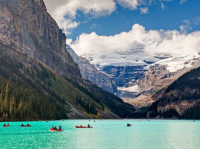 <p>Set inside Banff National Park in the Canadian Rockies, Lake Louise is a year-round resort destination. On a sunny day, the impossibly blue lake reflects the surrounding snowcapped mountains.</p>