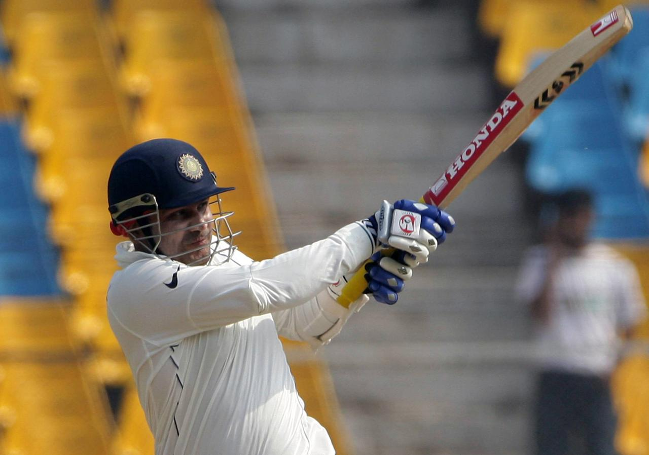 AHMEDABAD, INDIA - APRIL 5:  Virender Sehwag hits his 1st of 2 sixes in the 1st over off Dale Steyn during Day 3 of the second test match between India and South Africa held at Sardar Patel Gujarat Stadium on April 5, 2008 in Motera, Ahmedabad, India. (Photo by Duif du Toit/Gallo Images/Getty Images)