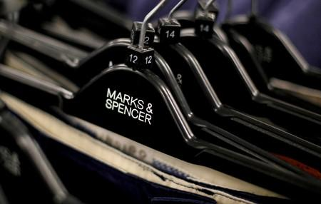 FILE PHOTO: File photo of clothes displayed on hangers in an Marks & Spencer shop in northwest London