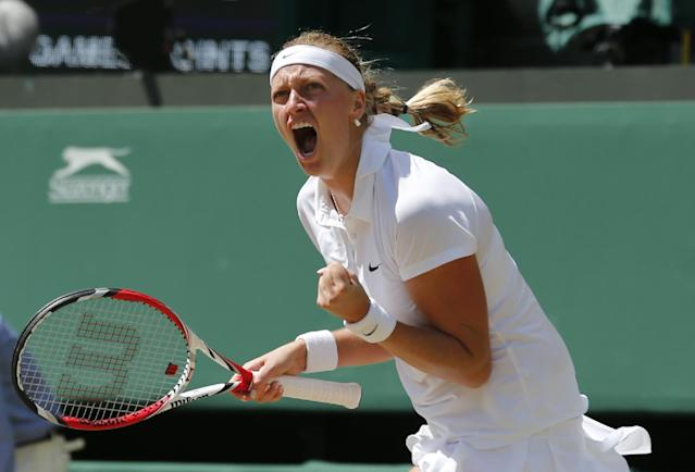 Petra Kvitova of Czech Republic celebrates winning the first set as she plays against Lucie Safarova of Czech Republic during their women's singles semifinal match at the All England Lawn Tennis Championships in Wimbledon, London, Thursday, July 3, 2014. (AP Photo/Ben Curtis)