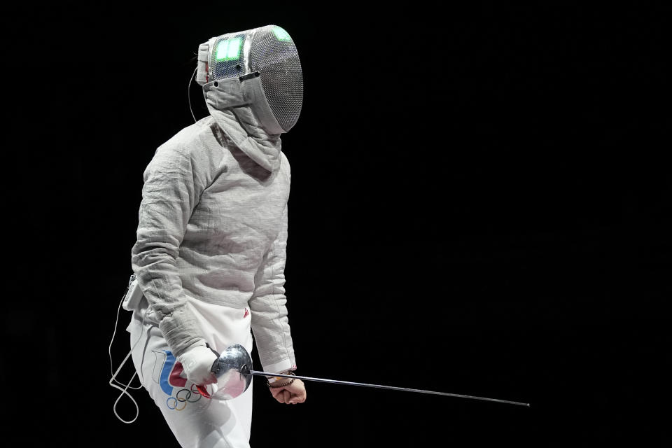 Sofia Pozdniakova of the Russian Olympic Committee celebrates winning a point as competes Cecilia Berder of France in the women's Sabre team final competition at the 2020 Summer Olympics, Saturday, July 31, 2021, in Chiba, Japan. (AP Photo/Hassan Ammar)
