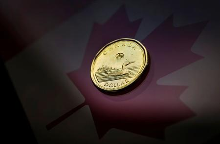 Loonie hits eight-day low as U.S. data boosts greenback