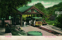 In this undated photo provided by Hong Kong Peak Tramways, a 1st generation Peak Tram which serviced from 1988 to 1926 is seen in Hong Kong. The Peak Tram started operations in 1888, when Hong Kong was a British colony, to transport people up Victoria Peak instead of using sedan chairs. The original carriages were made of varnished timber and seated 30 passengers in three classes. (Hong Kong Peak Tramways via AP)