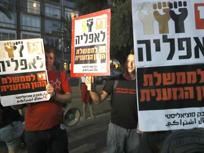 Demonstrators attend a rally to protest against the nation state bill in Tel Aviv on 14 July (AFP/Getty)