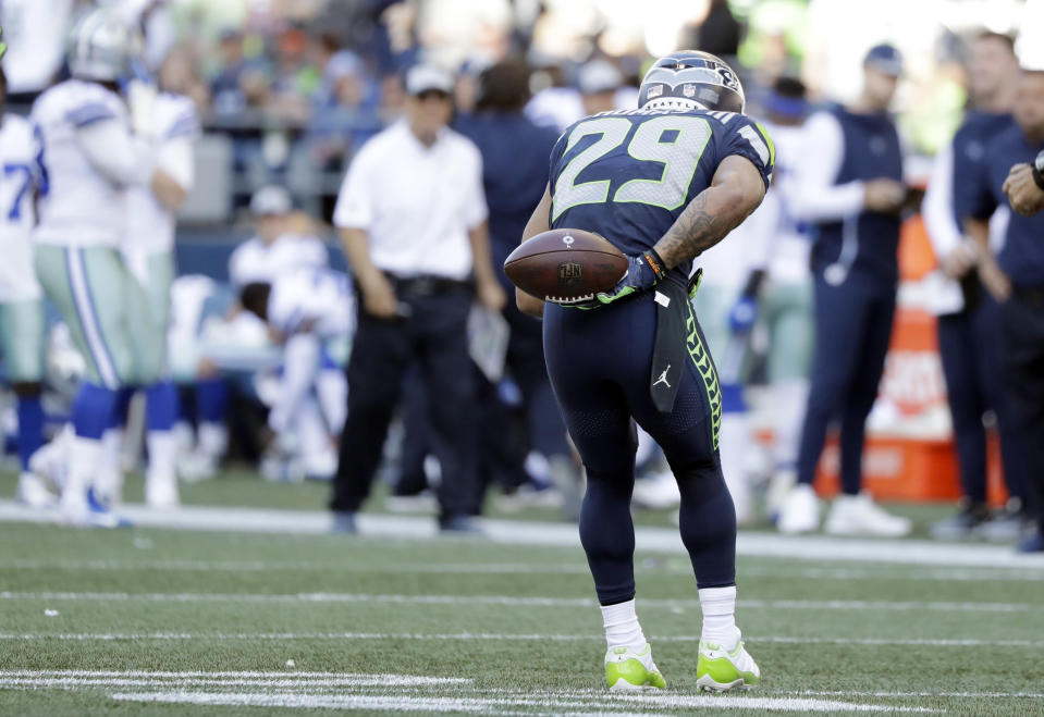 Earl Thomas bowed at the Cowboys' bench after he intercepted a pass in a game the Seahawks won in Week 3. (AP)