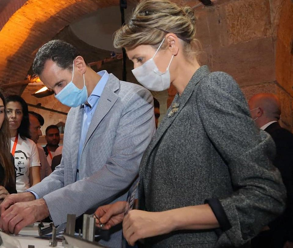Syrian President Bashar al-Assad and his wife Asma wearing face masks during the pandemic in November (SANA/AFP via Getty Images)