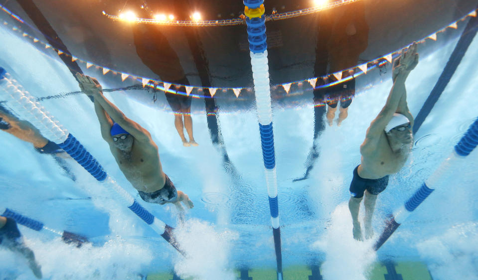 Brendan Hansen, left, and Michael Phelps swim in the men's 400-meter individual medley final at the U.S. Olympic swimming trials, Monday, June 25, 2012, in Omaha, Neb. (AP Photo/David Phillip)